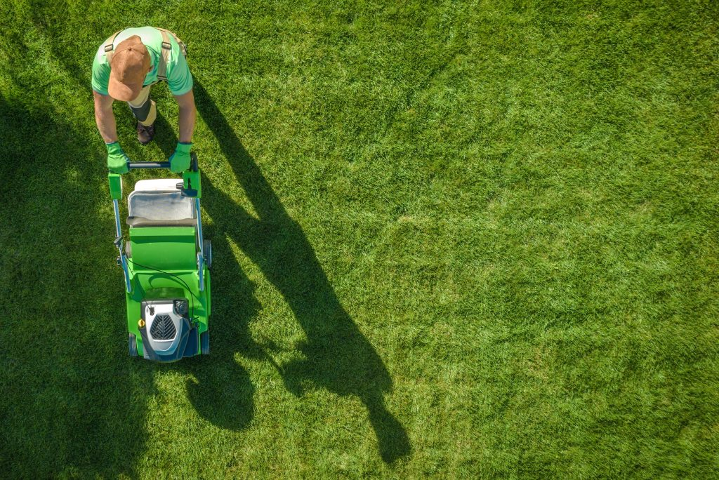Aerial view of lawn mowing man - mobile mower techs